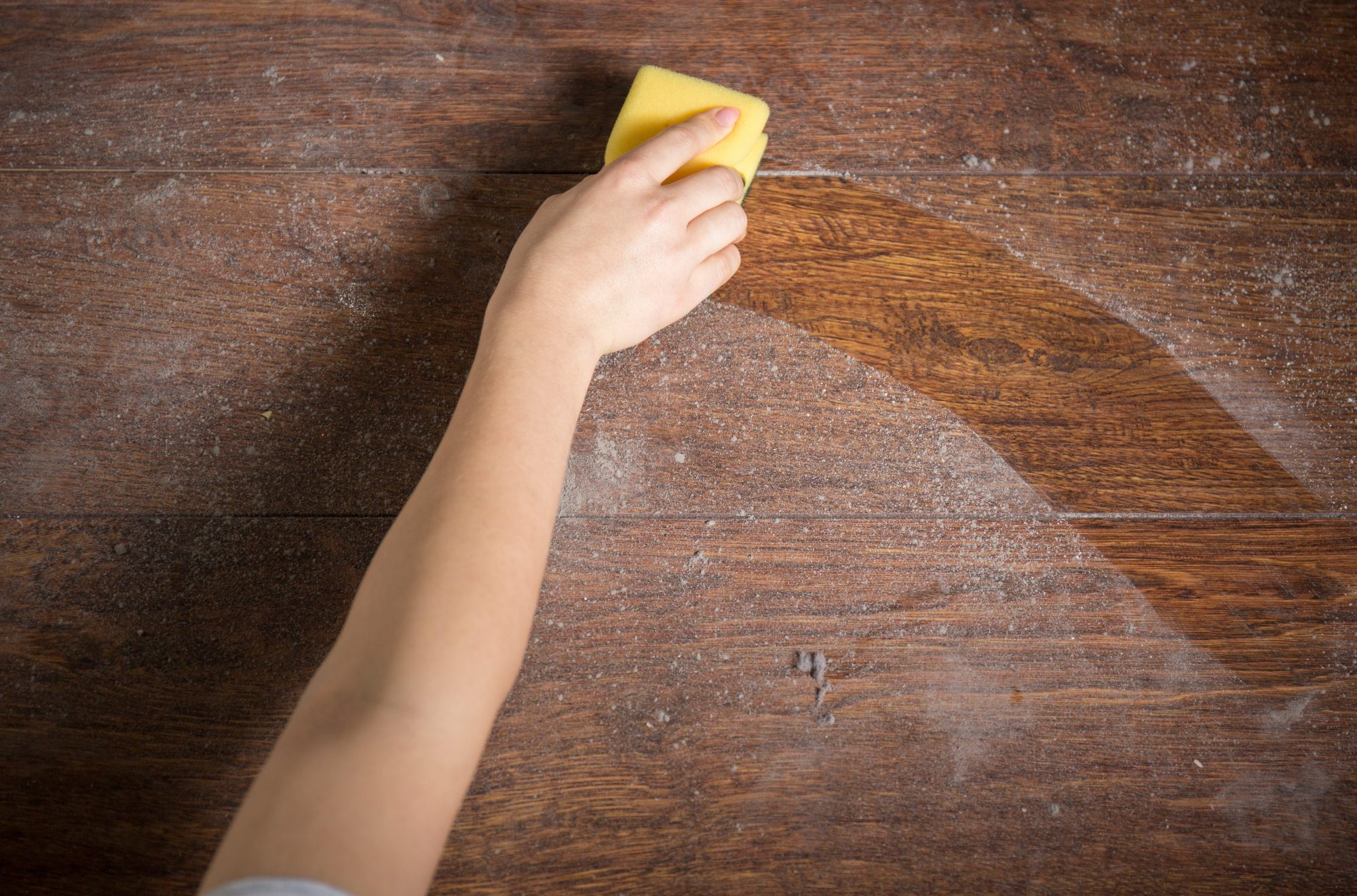 Hand cleaning dust household chemicals with sponge