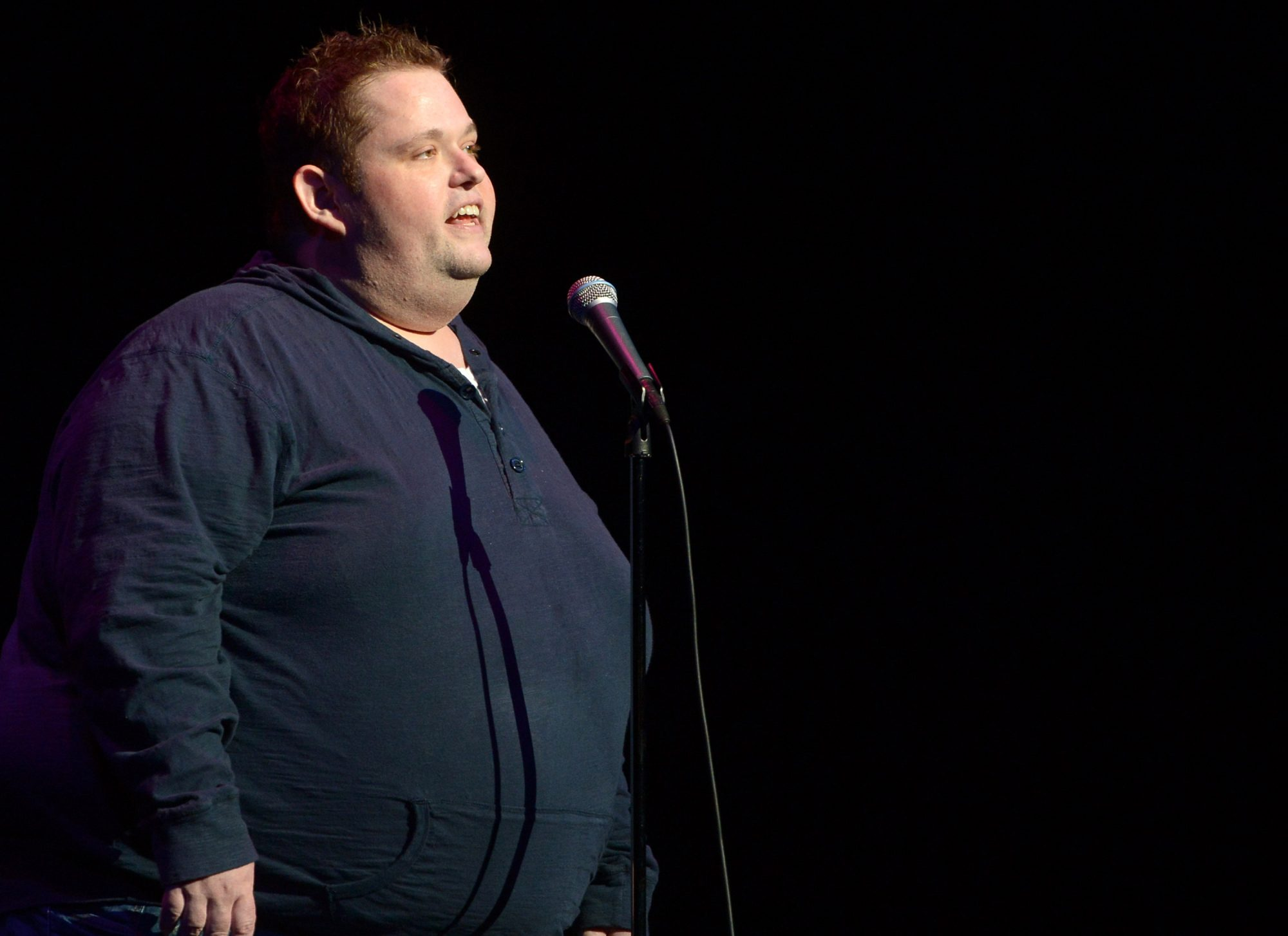 Comedian Ralphie May on stage before his death from hypertensive cardiovascular disease