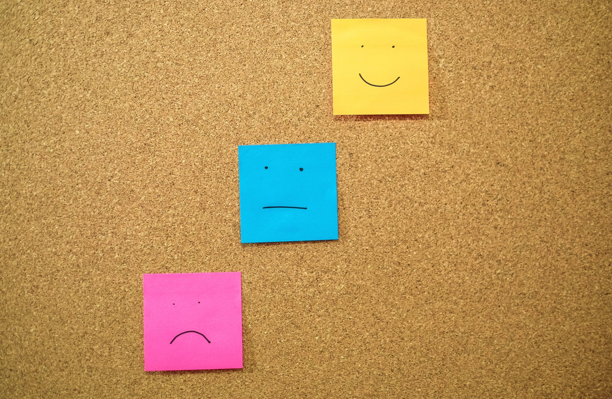 Colorful Papers With Anthropomorphic Faces Stuck On Wall