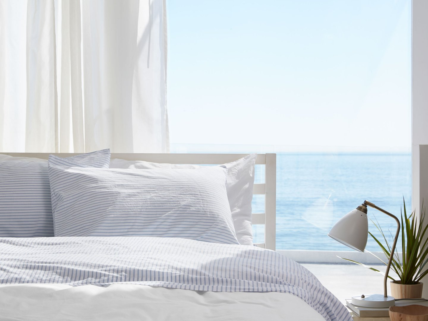 Blue striped percale bedding by ocean