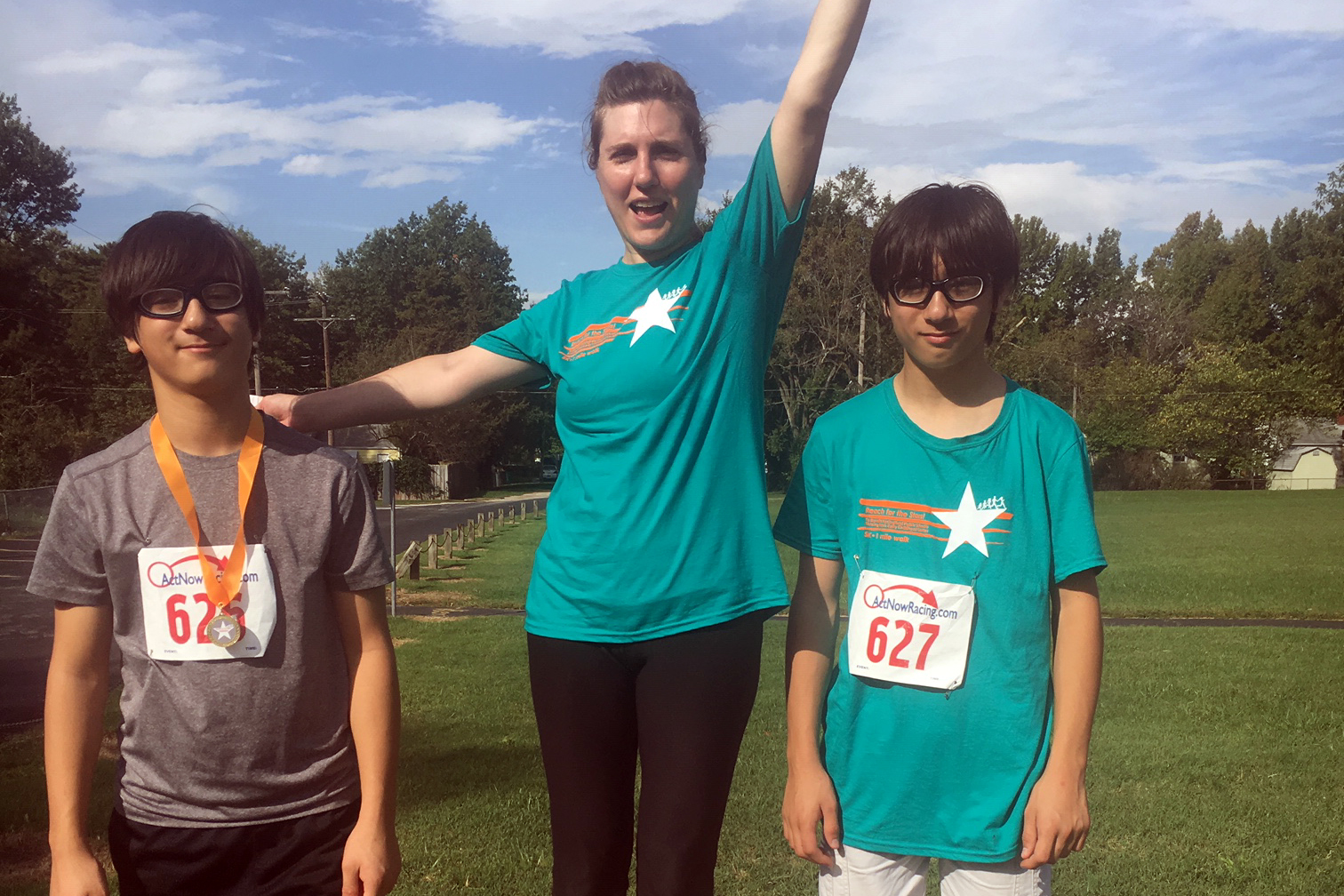 Ashlea Betzen-Miyauchi with her boys, Kay and Sho, at the 3rd Annual Reach for the Stars 5K race for Shining Stars Early Childhood Center in Springfield, Missouri, October 6, 2018.