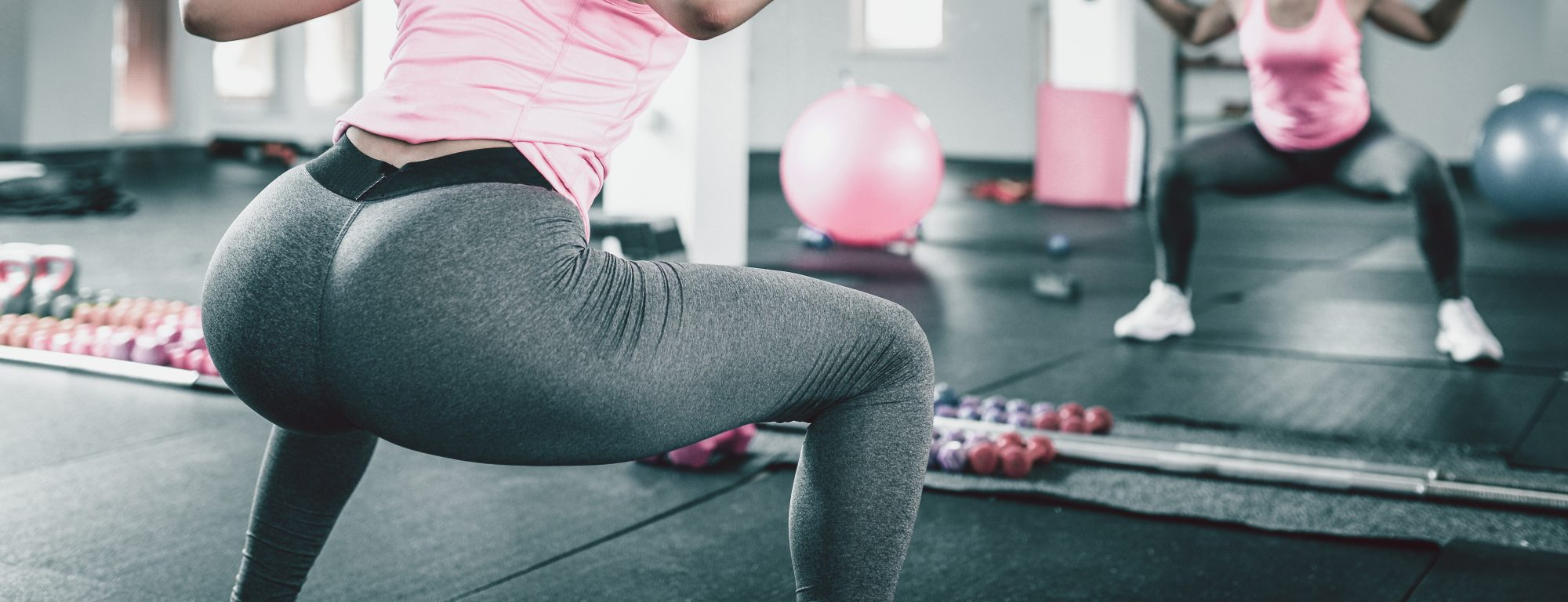 3 Squat Mistakes People Make at the Gym—And How to Fix Them