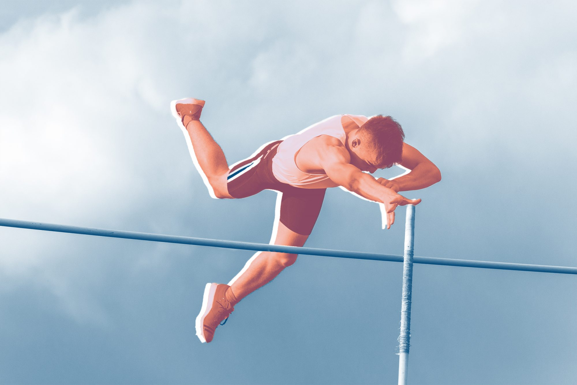 Front view of young male athlete jumping over the leath, teenager