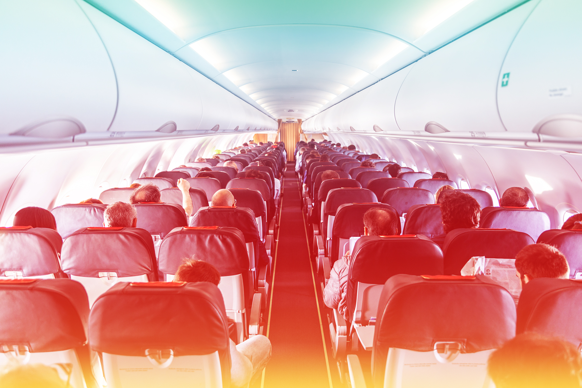 Interior of commercial airplane with passengers on their seats during flight. , southwest-flight-health-care-workers-covid-19 , southwest-flight , health-care-workers , covid-19