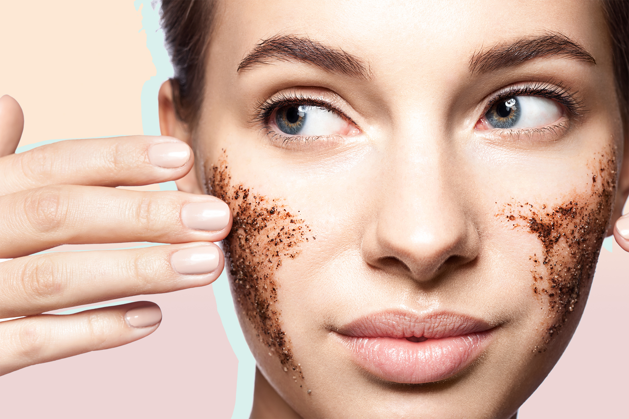 Close-up portrait of a beautiful woman with a coffee scrub on her face doing peeling skin isolated on white background