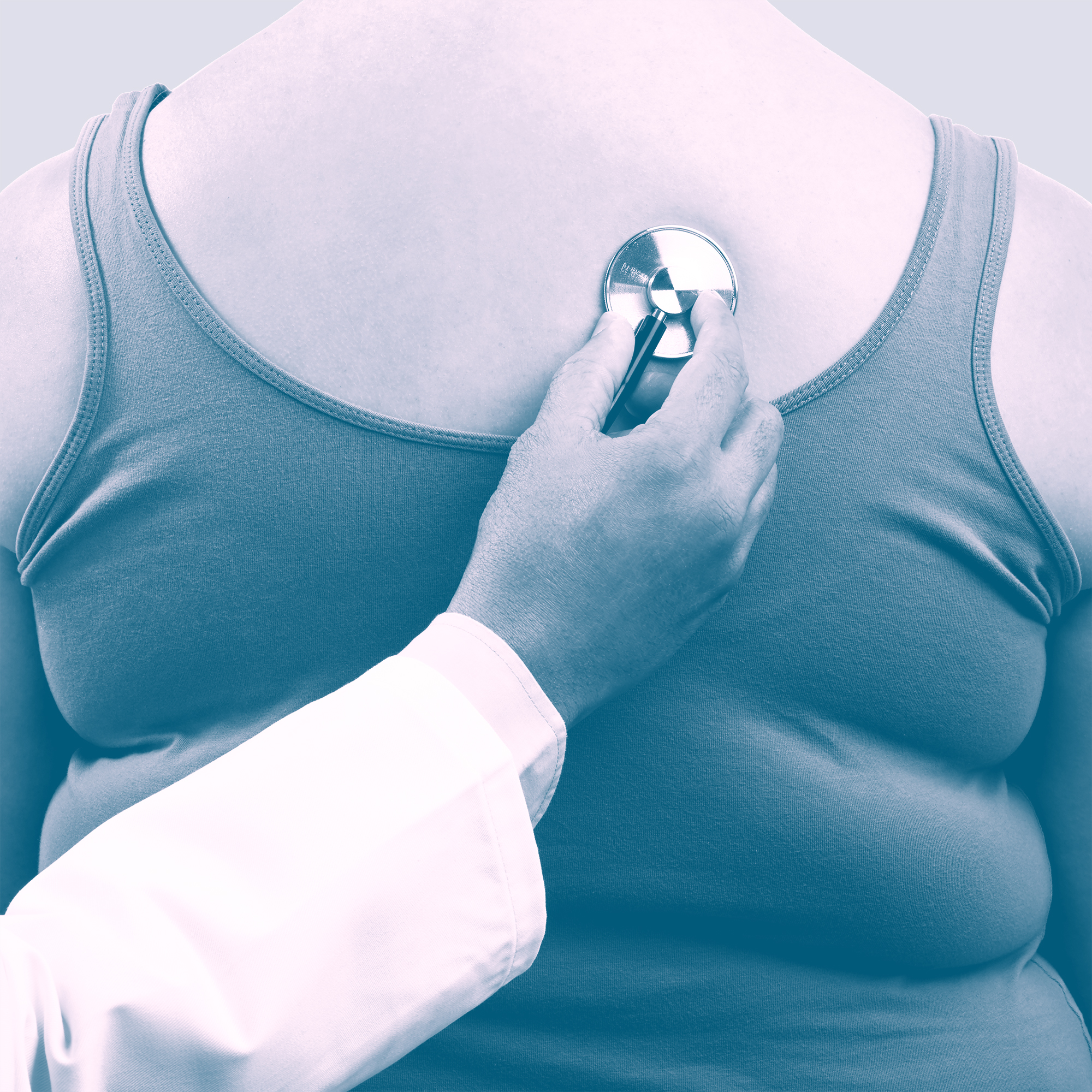 Doctor examining overweight woman