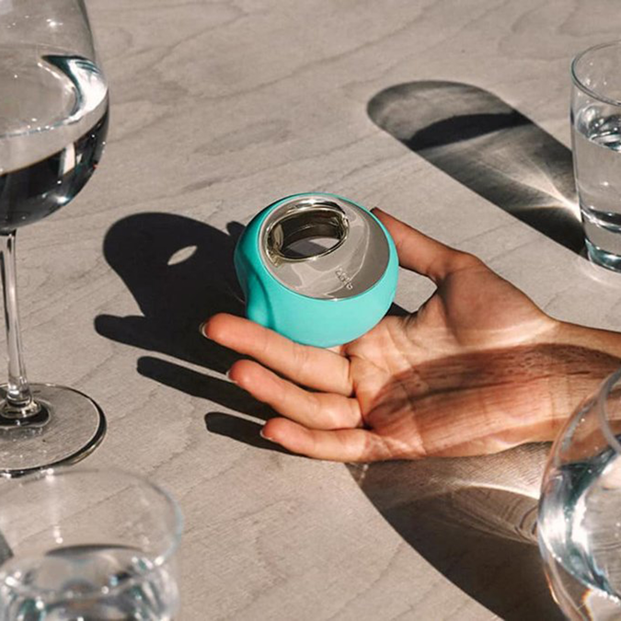 Lelo Ora 3 Vibrator in aqua blue with wine glasses