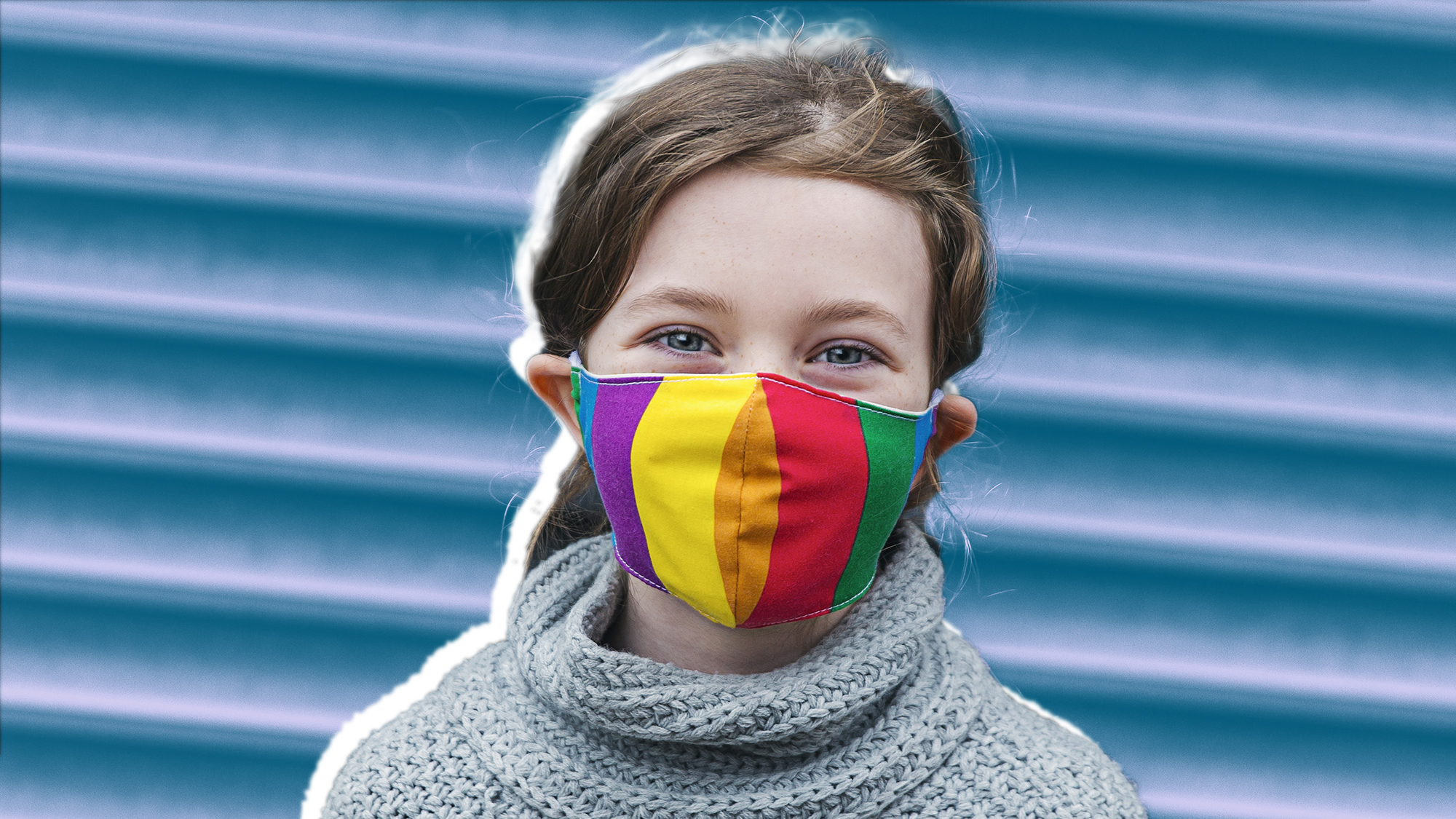 Best Face Masks for Kids , Young girl smiling behind her rainbow mask