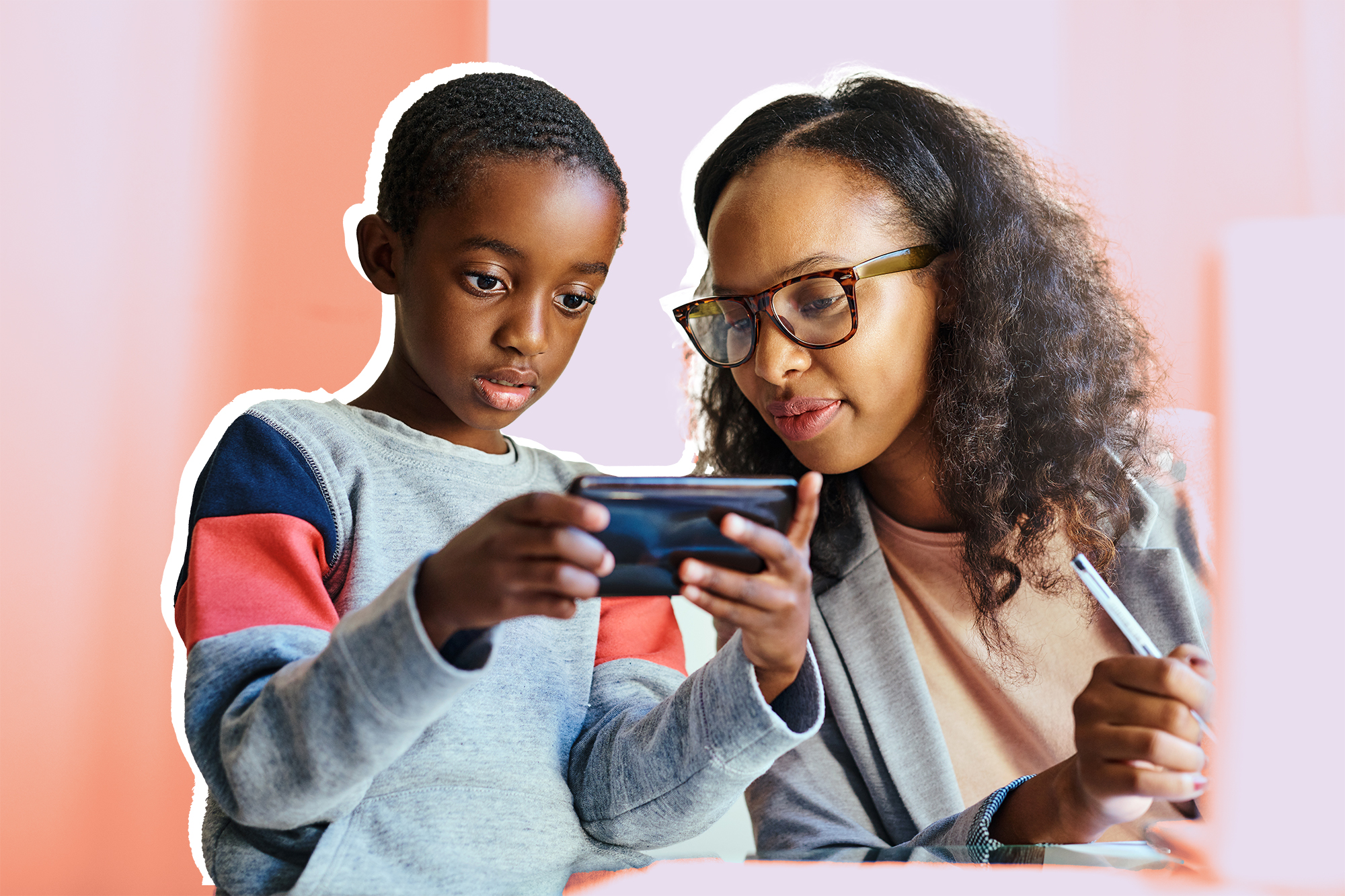 new teacher challenge , Shot of a cute young boy showing his mother something on a smartphone while she works at home