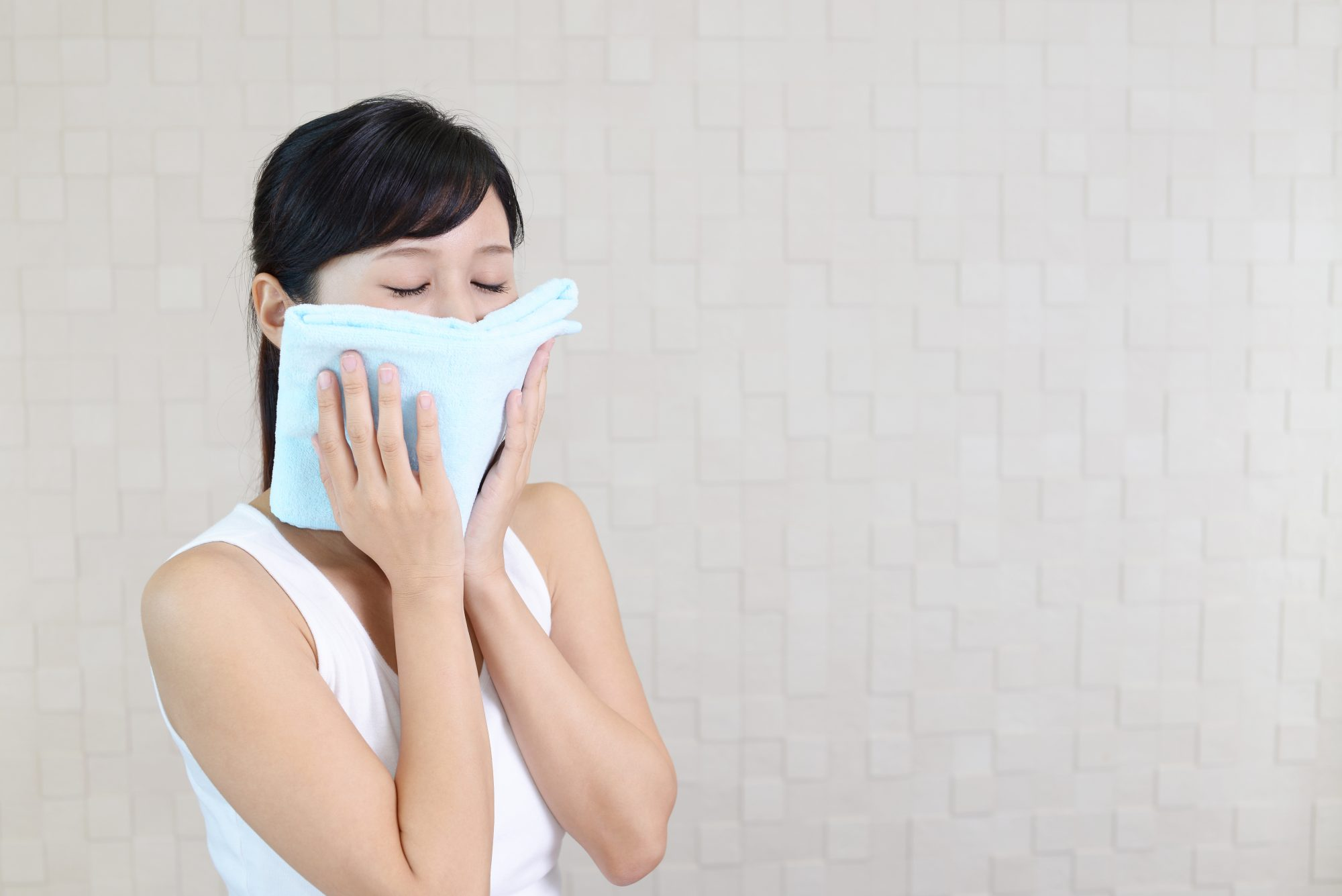 woman with towel on face