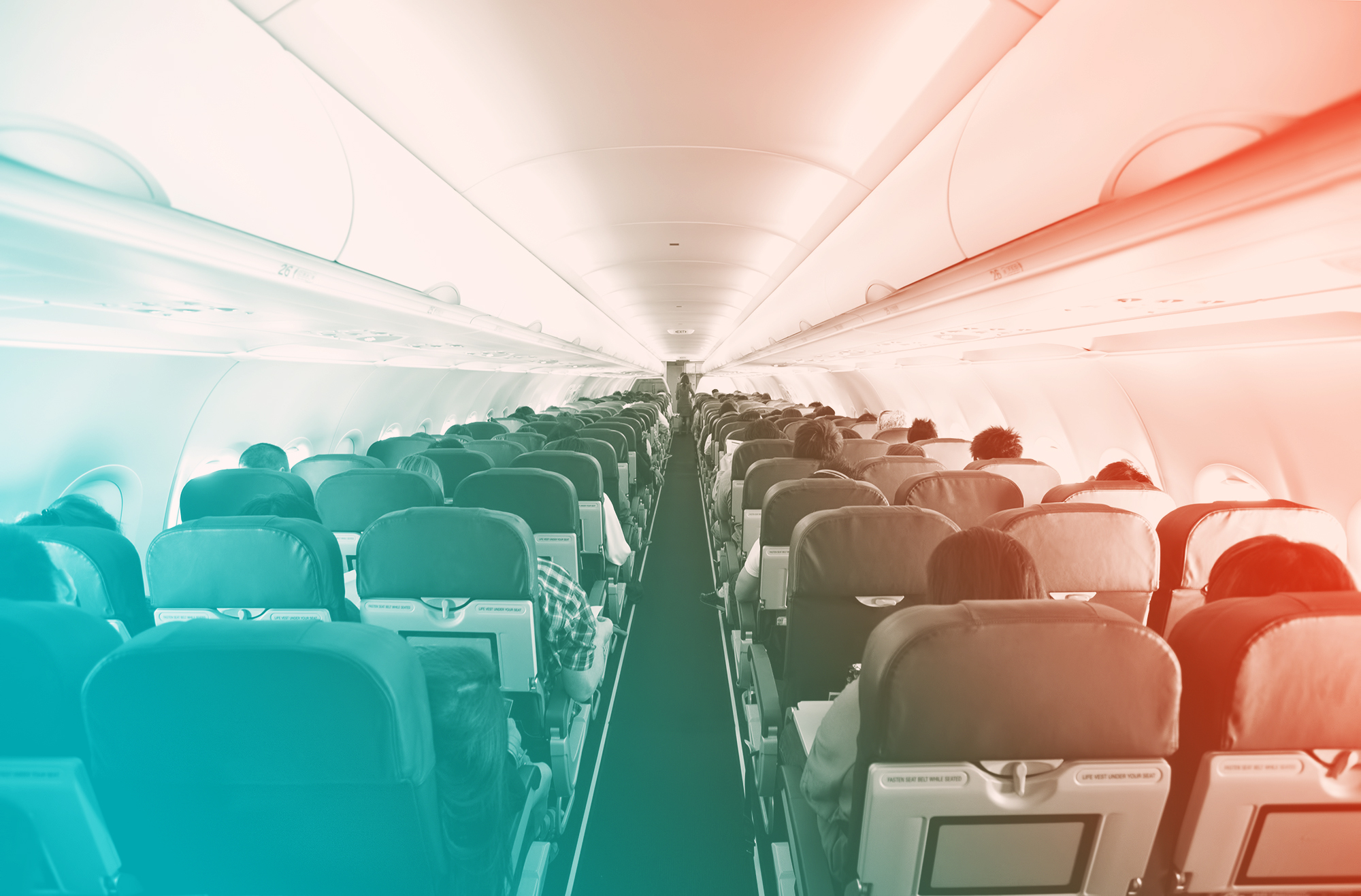 woman dies of COVID in airplane , Passengers inside the cabin of a commercial airliner during flight. Shallow depth of field with focus on the seats in the foreground.
