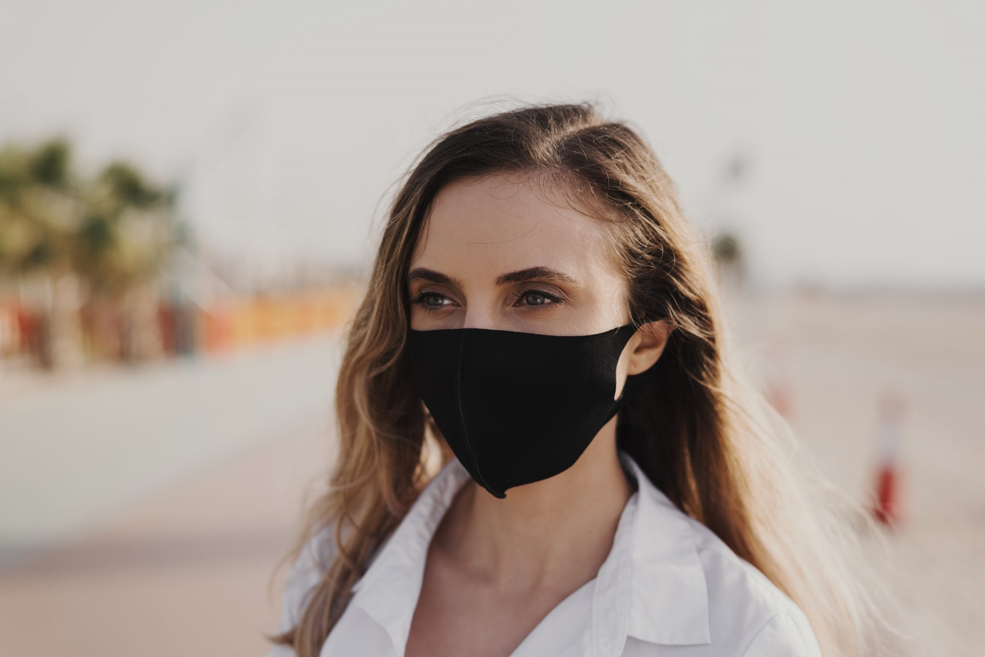 face-mask-brackets , Portrait of a young woman wearing black protective face mask. Reusable mask. Dust protection. Covid 19 or coronavirus pandemic concept