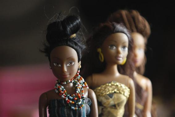 A bead necklace is seen on a doll dressed in local attire, in a workshop in Surulere district, in Nigeria's commercial capital Lagos