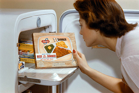 Woman Choosing TV Dinner from Freezer