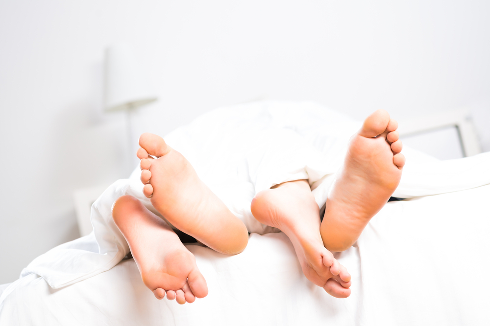 Picture of Feet Sticking Out From Under the Covers