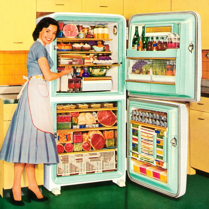 Homemaker Showing a Full Refrigerator