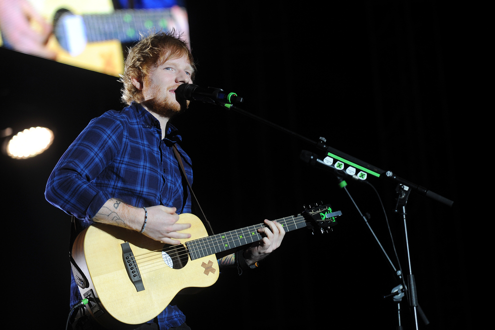 Picture of Ed Sheeran Singing and Playing Guitar on Stage