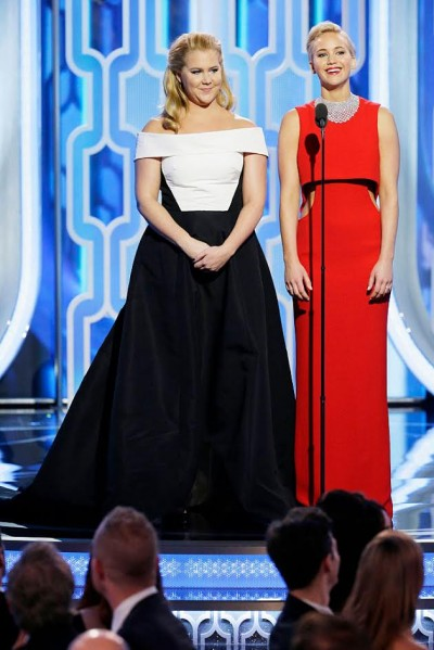 BEVERLY HILLS, CA - JANUARY 10: In this handout photo provided by NBCUniversal,  Presenters Amy Schumer and Jennifer Lawrence speak onstage during the 73rd Annual Golden Globe Awards at The Beverly Hilton Hotel on January 10, 2016 in Beverly Hills, California.  (Photo by Paul Drinkwater/NBCUniversal via Getty Images)