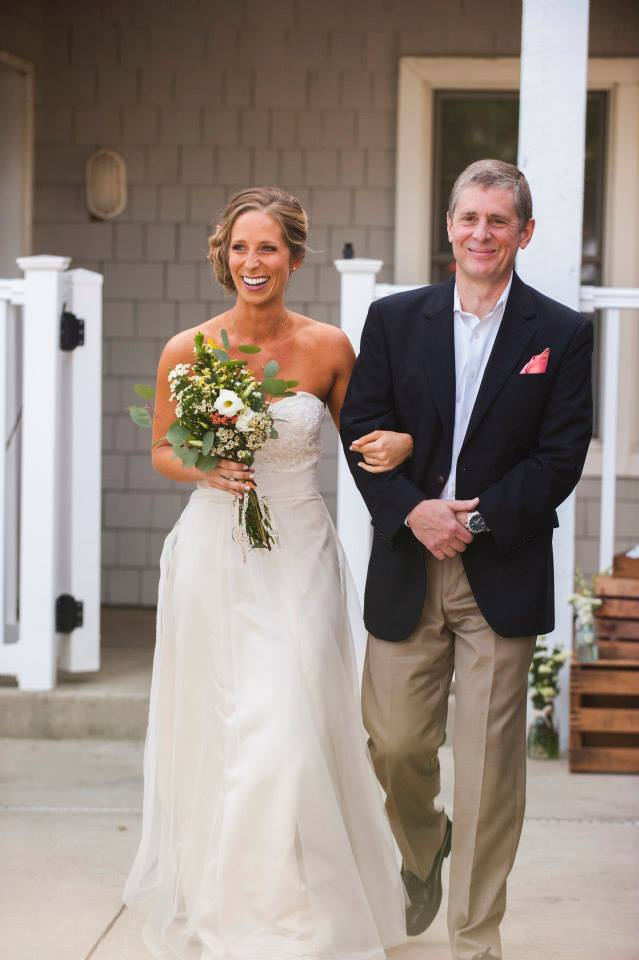 My dad walking me down the aisle/pool deck.