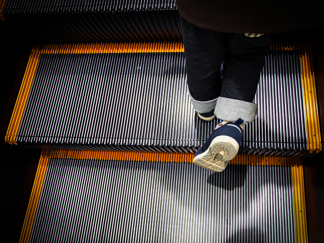 Picture of Person Standing on an Escalator