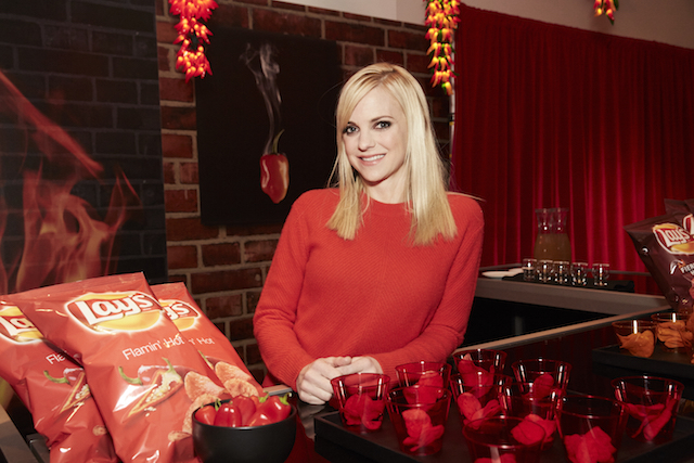 """Flavor enthusiast and actress Anna Faris reveals the all-new Lay's """"Flavor Swap"""" program – where America helps decide which flavors stay and which go – at an immersive launch event in New York City on January 20, 2016. (Stephanie Diani/AP Images for Frito-Lay)"""