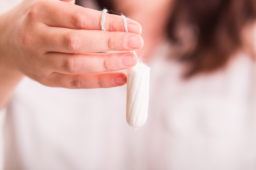 Woman holding a tampon - close up