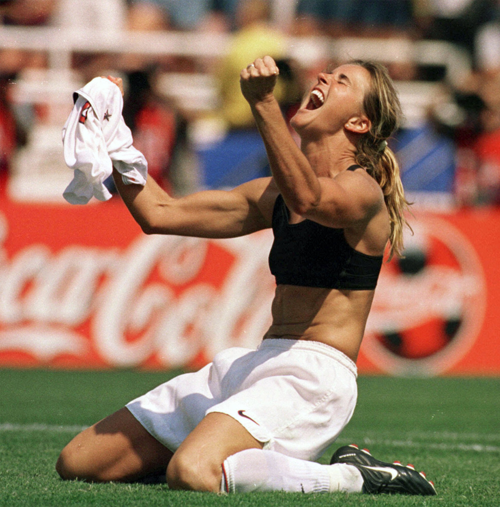 FILE - In this July 10, 1999 file photo, the United States' Brandi Chastain celebrates by taking off her jersey after kicking in the game-winning penalty shootout goal against China in the Women's World Cup Final at the Rose Bowl in Pasadena, Calif. On Monday Aug. 19, 2013,  Mia Hamm, Julie Foudy and Chastain visited a soccer camp in Manhattan and promoted