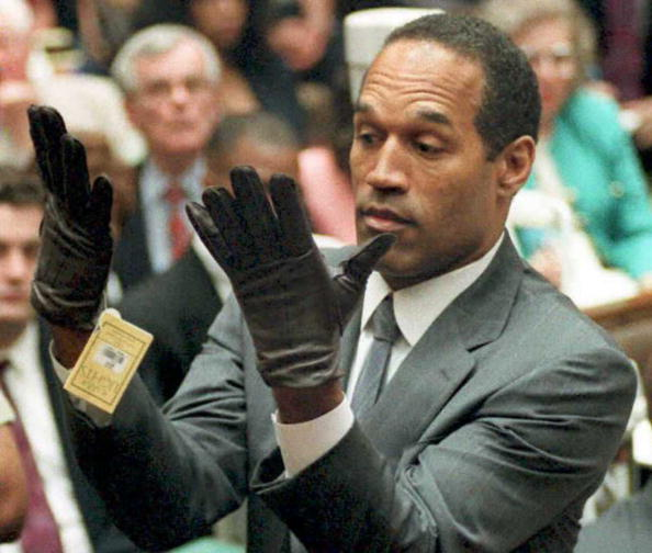 (YEARENDER 13) O.J. Simpson looks at a new pair of