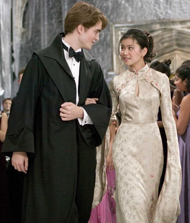 """ROBERT PATTINSON as Cedric Diggory and KATIE LEUNG as Cho Chang in Warner Bros. Pictures' fantasy """"Harry Potter and the Goblet of Fire.""""                     PHOTOGRAPHS TO BE USED SOLELY FOR ADVERTISING, PROMOTION, PUBLICITY OR REVIEWS OF THIS SPECIFIC MOTION PICTURE AND TO REMAIN THE PROPERTY OF THE STUDIO. NOT FOR SALE OR REDISTRIBUTION."""