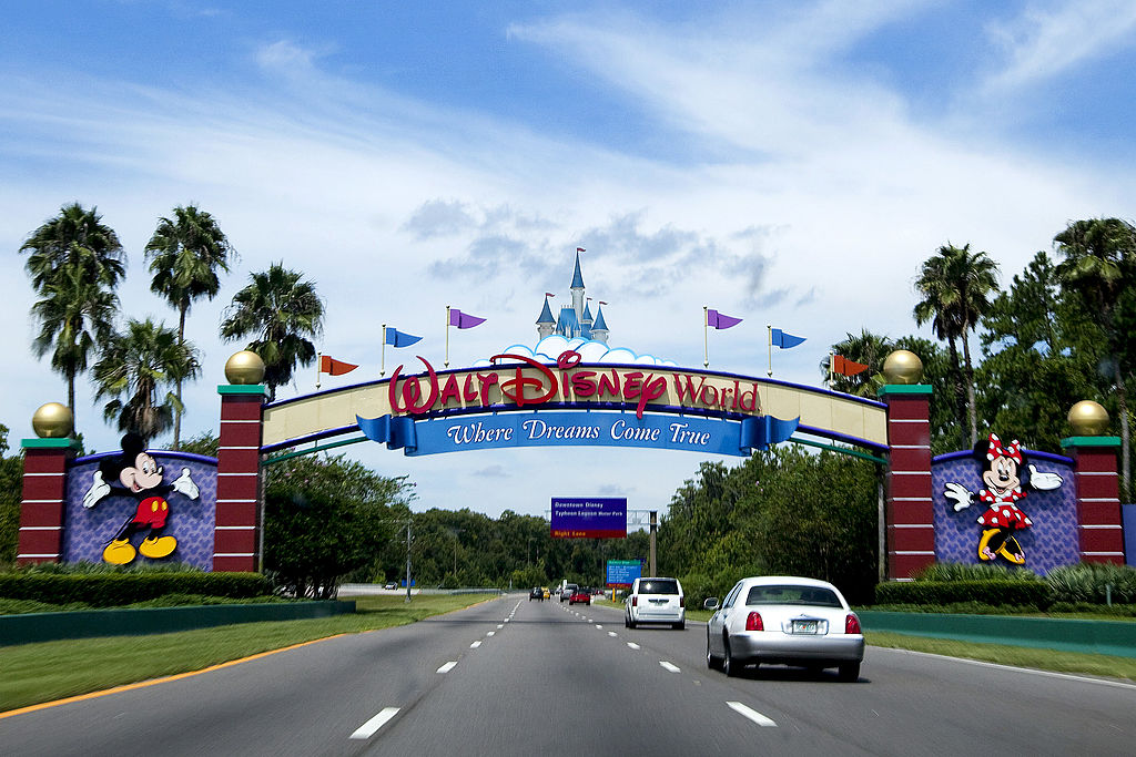 Vehicles pass the entrance to the Walt Disney World theme pa