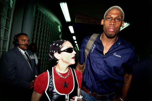 LOS ANGELES - APRIL 24 1994:  Dennis Rodman #10 of the San Antonio Spurs is seen leaving the arena with Madonna after playing an NBA game against the Los Angeles Clippers at The Los Angeles Sports Arena on April 24, 1994 in Los Angeles, California.  The Spurs defeated the Clippers 112-97.  NOTE TO USER: User expressly acknowledges and agrees that, by downloading and/or using this Photograph, user is consenting to the terms and conditions of the Getty Images License Agreement.  Mandatory Copyright Notice: Copyright 2004 NBAE (Photo by Andrew D. Bernstein/NBAE via Getty Images)