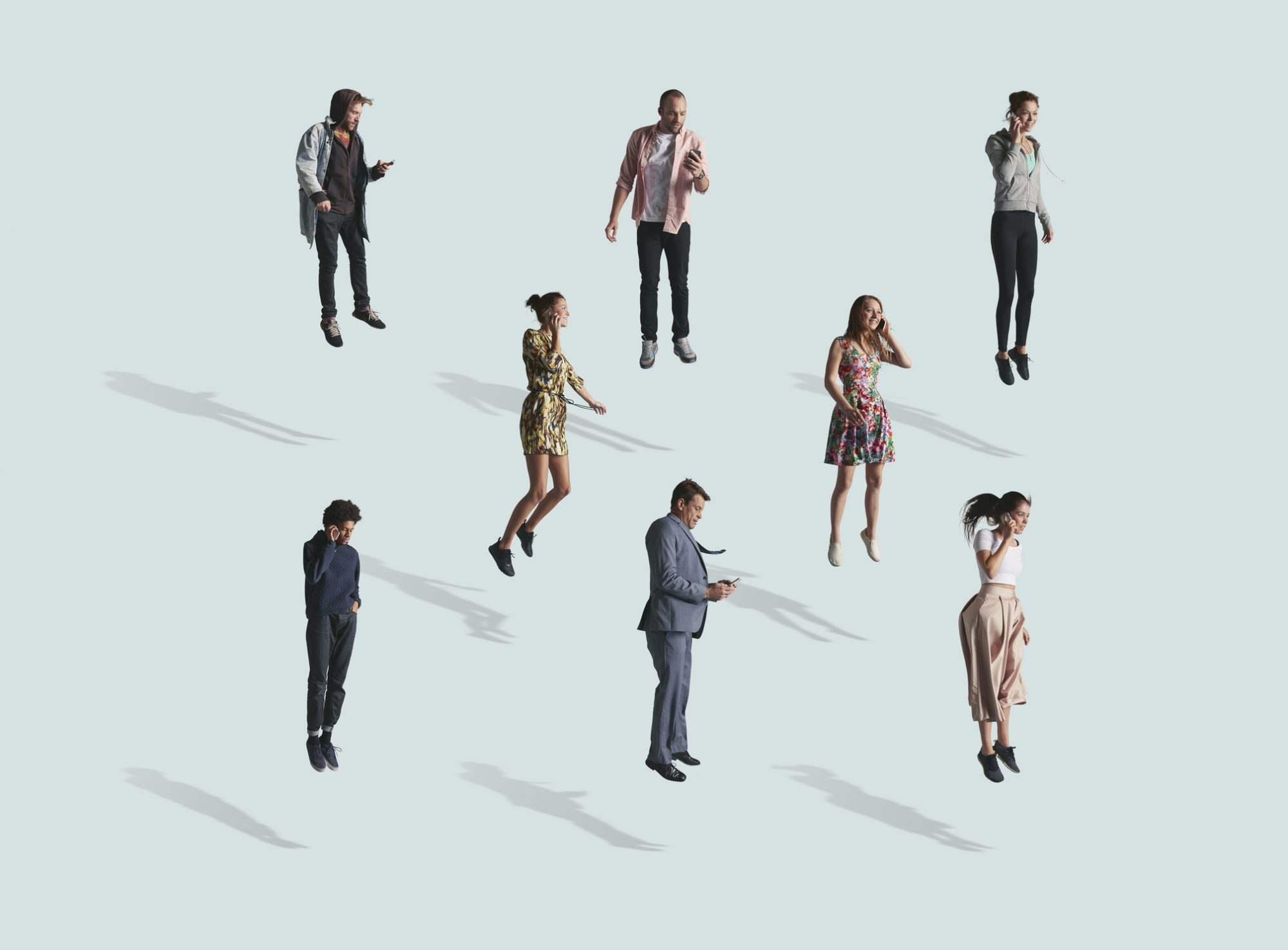 Group of people using phone while jumping