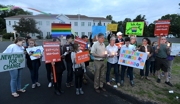 Nearly two dozen protesters showed up in front of the National Shooting Sports Foundation in Newtown, Conn., for a candlelight vigil to remember the victims of the Orlando mass shooting on Sunday, June 12, 2016. (Peter Casolino/Hartford Courant/TNS via Getty Images)