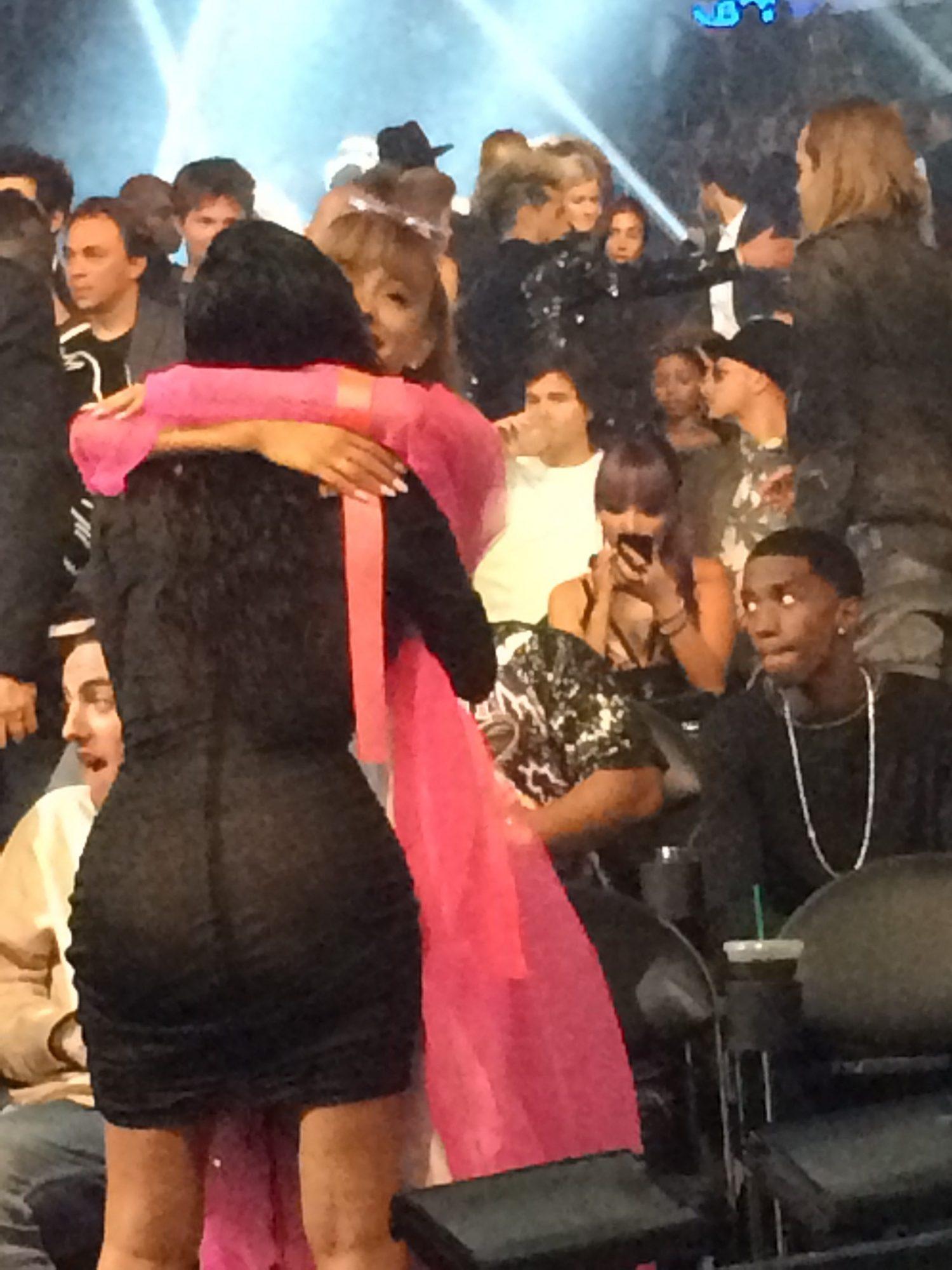 Kim Kardashian and Ariana Grande sharing a hug.