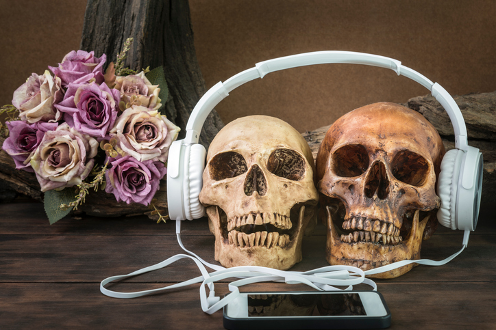 still life with couple skull listening to music