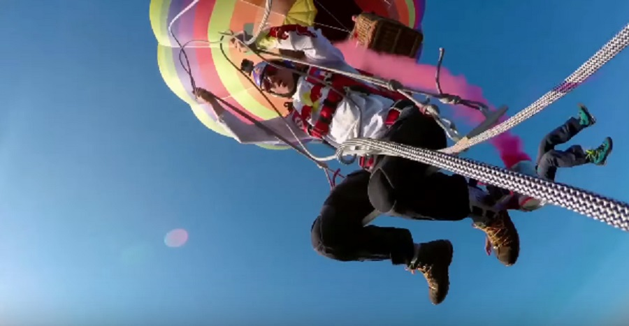 skydivers swing from hot air balloon