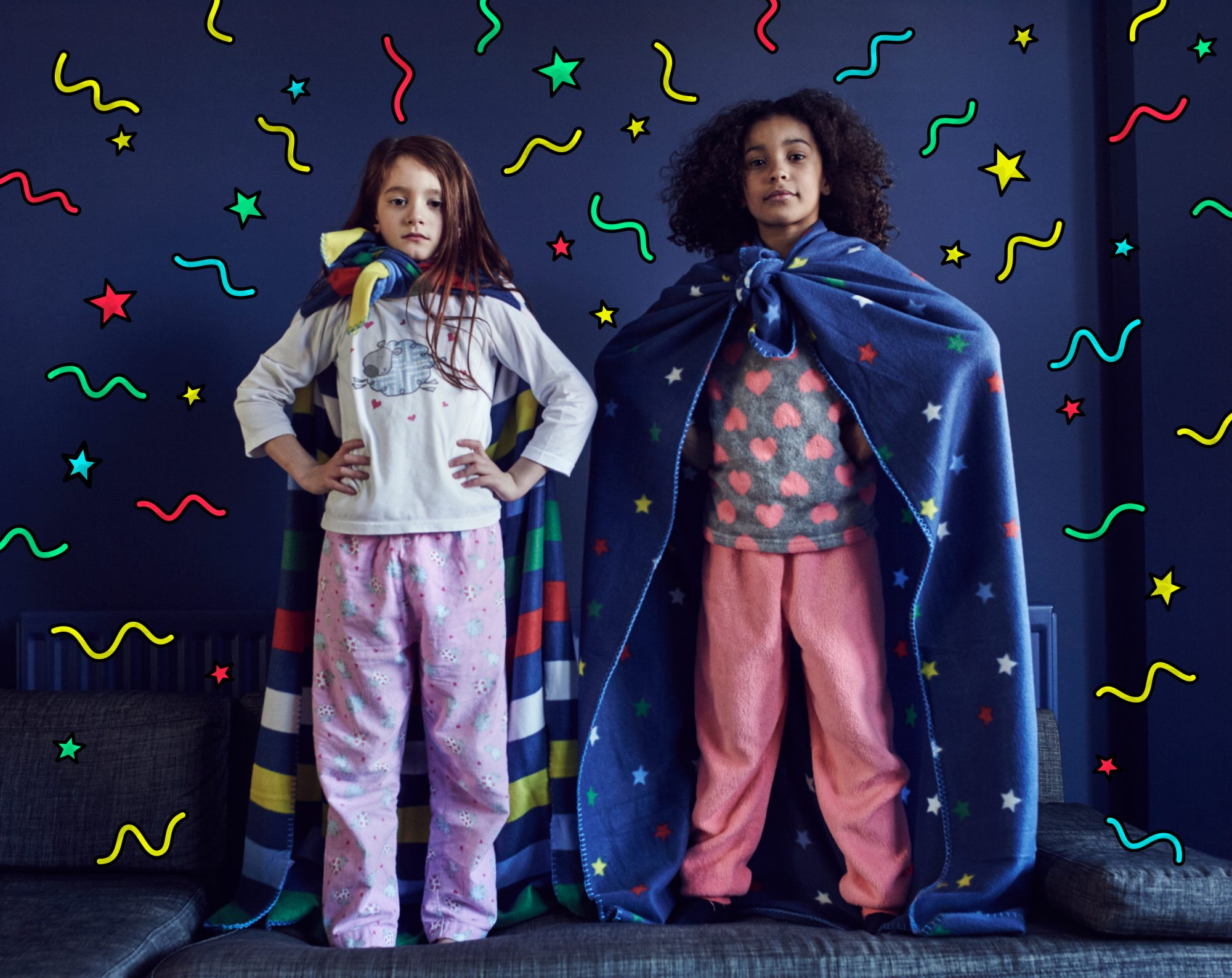 Girls dressed as Superheroes with graphic symbols