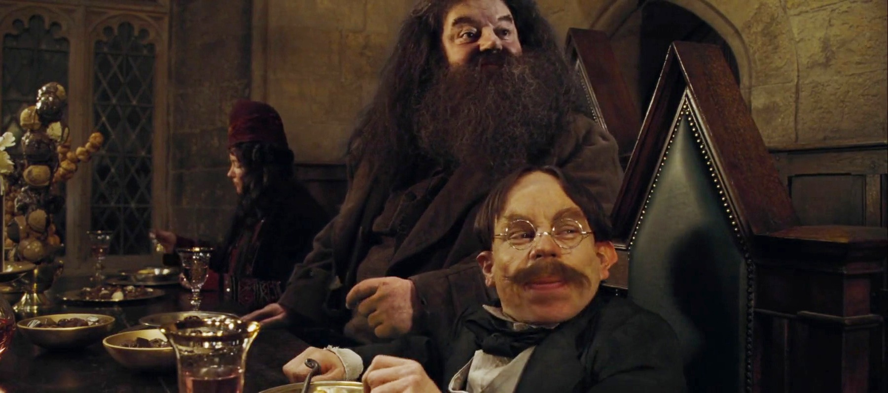hagrid_and_flitwick_at_the_high_table