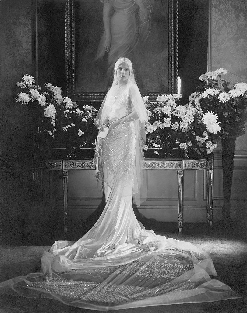 Mrs. Charles Coudert Nast (nee Charlotte Babcock Brown) (Conde Nast's daughter-in-law) wearing wedding dress with very long train and tulle veil swirled on floor before her. (Photo byEdward Steichen/Condé Nast via Getty Images)