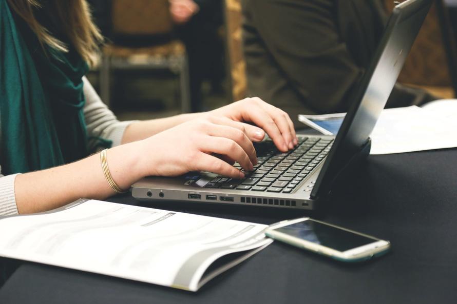 woman-typing-writing-windows-large.jpg