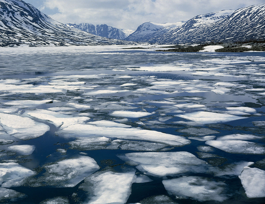 Geiranger Fjord - Spring, melting ice, snowy mountains behind