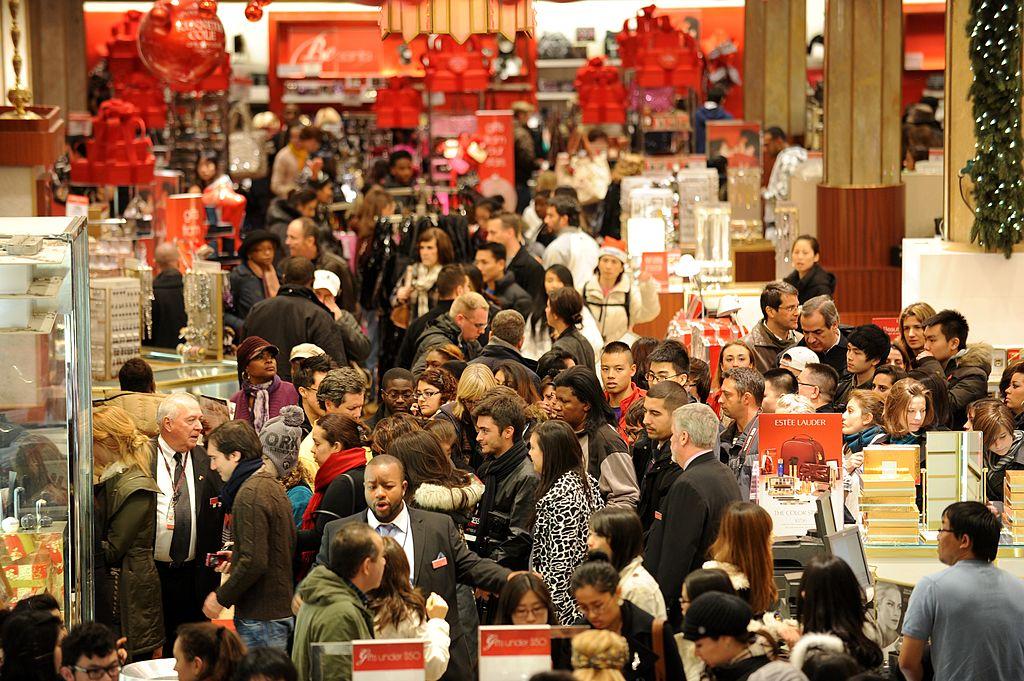 People crowd the aisles inside Macy's de