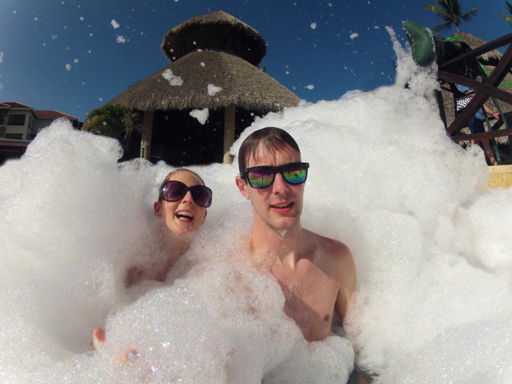 Couple on Honeymoon in Swimming pool foam party