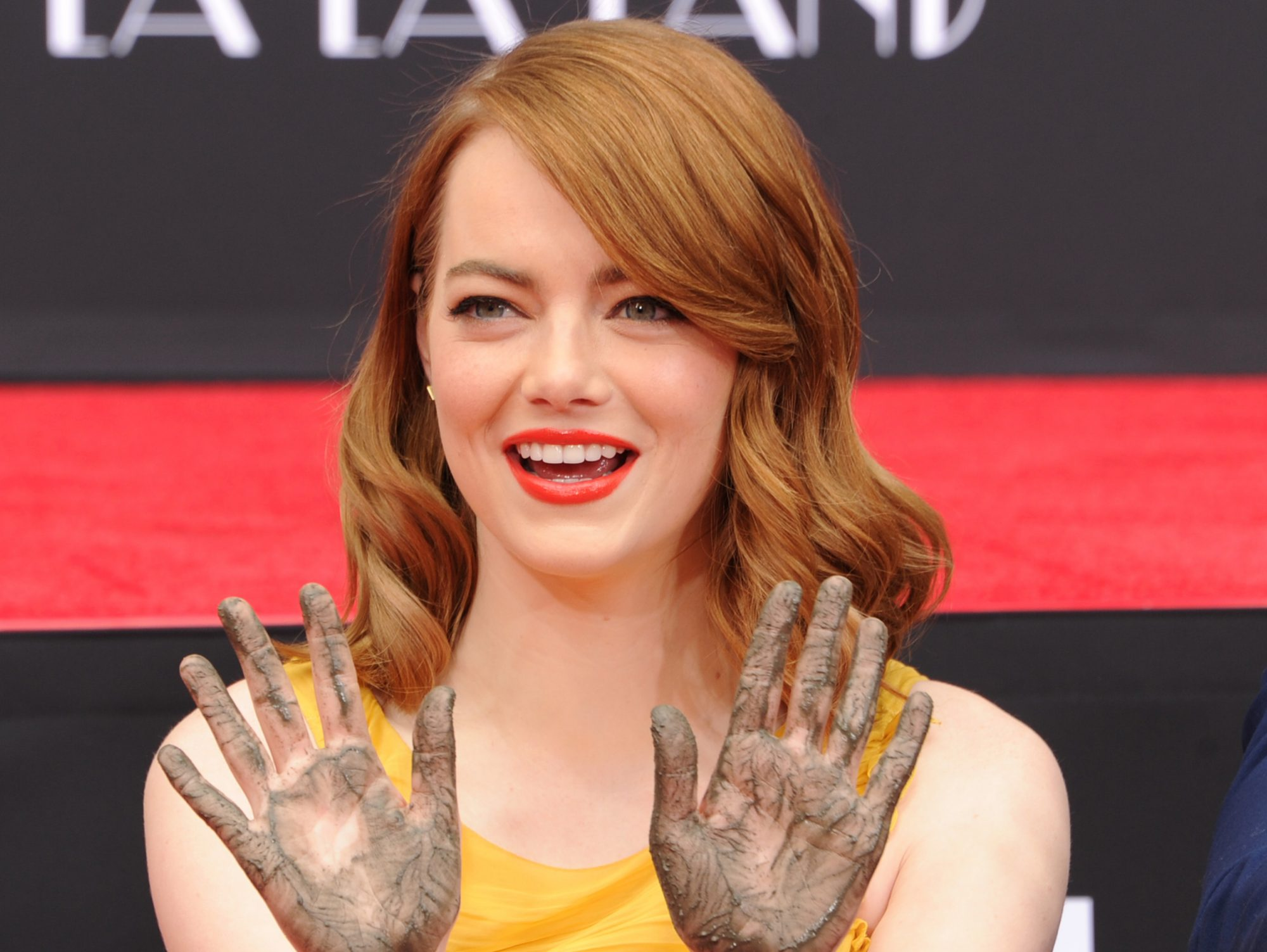 Emma Stone cement hands