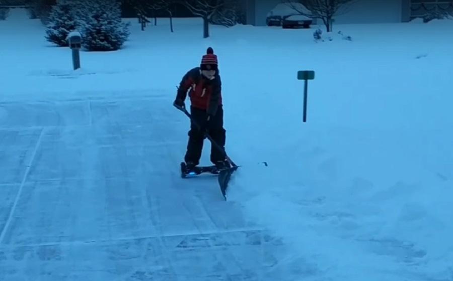 kid-shoveling-snow-hoverboard