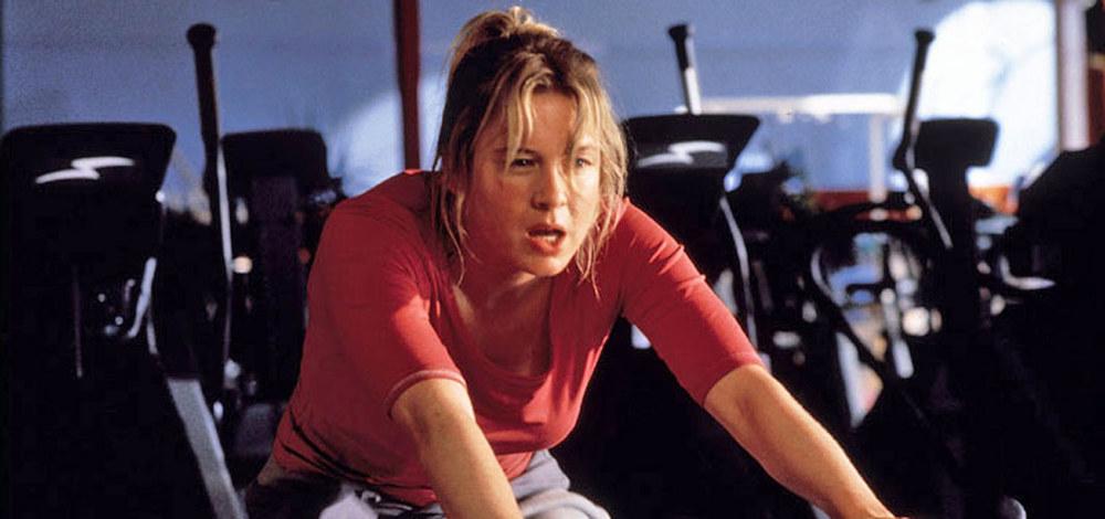 Bridget Jones on the bike at the gym.