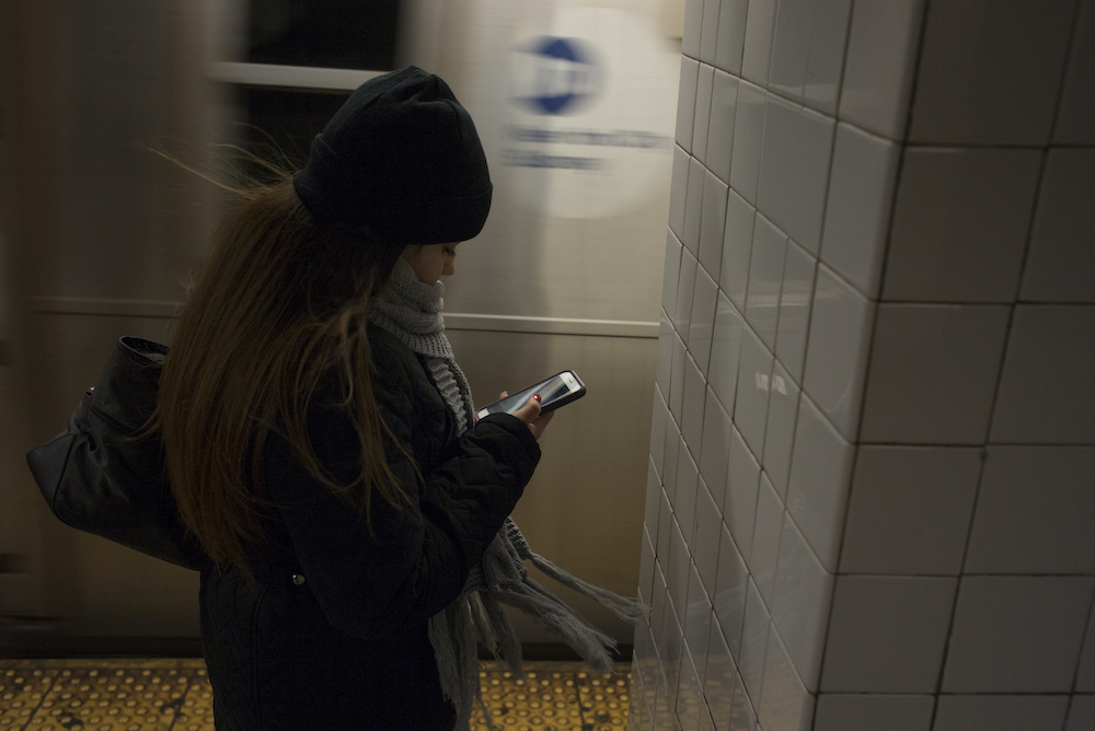 Woman checking her phone.