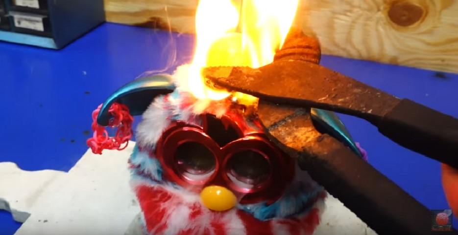 furby-burned-with-red-hot-nickel-ball