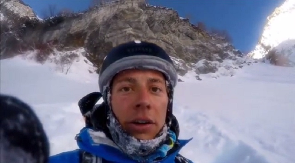 guy-skis-off-cliff