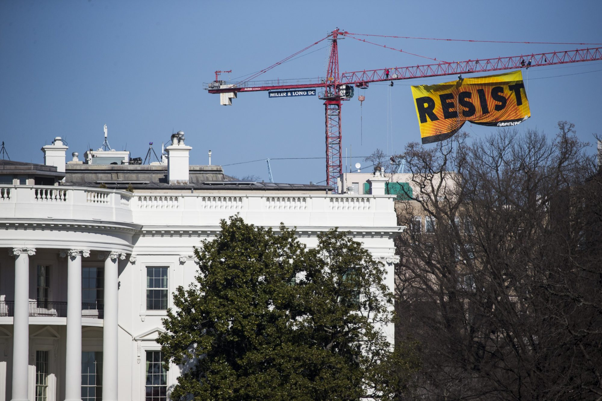 Greenpeace protestors climb construction crane in Washington